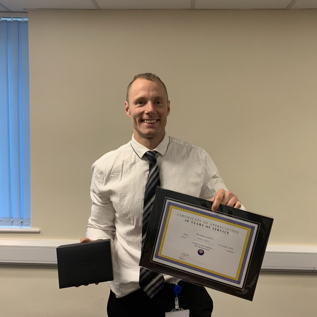 Adrian Smith receiving his 10 years of service award
