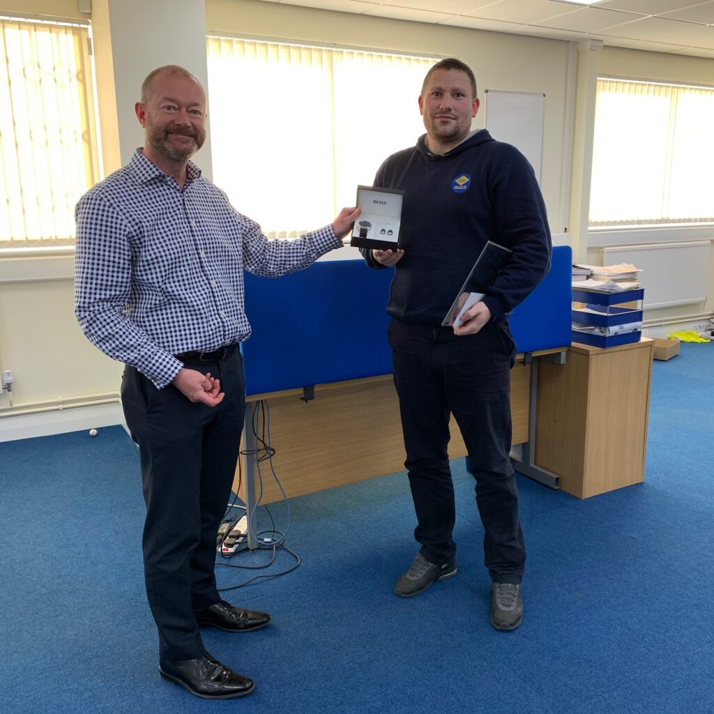 Gareth Cardwell receiving his 10 years of service award