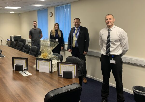 from left to right: Tyler Robertshaw (10 years), Jeanette Clifton (25 years), Steve Smith (Managing Director, presenting the awards) and Adrian Smith (10 years)