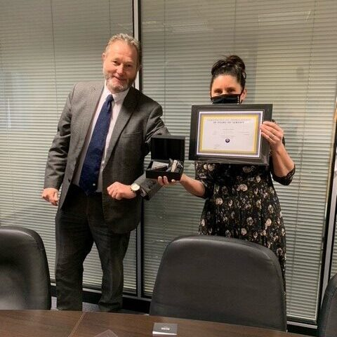 Hayley Baxter receiving her 10 years of service award from Tony Smith