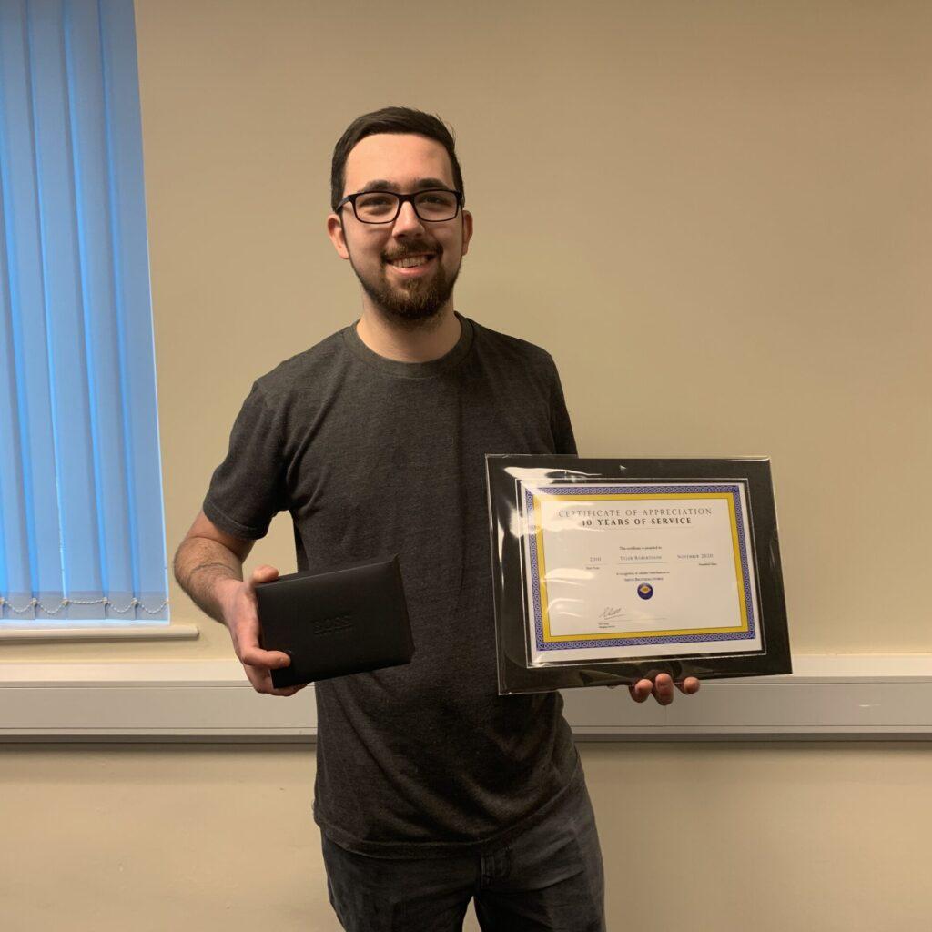 Tyler Robertshaw receiving his 10 years of service award
