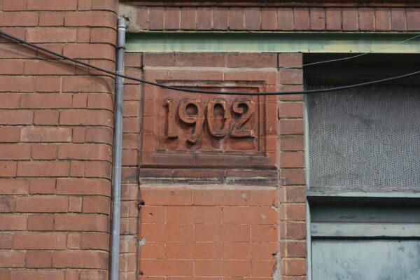 The date stone along Batten Street.