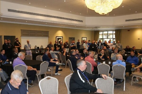 Briefing before going onto the course at the National Golf Day