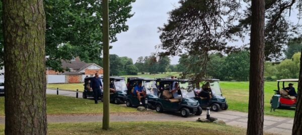 Guest getting into buggies ready to play Golf at the National Golf Day